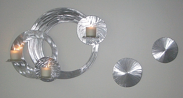 candle holder sculpture in brushed aluminum and metal, candle sconces hold 4 candles and comes complete with candles, glass candle holders, and candle holder sculpture. candle sculpture by Tony Viscardi