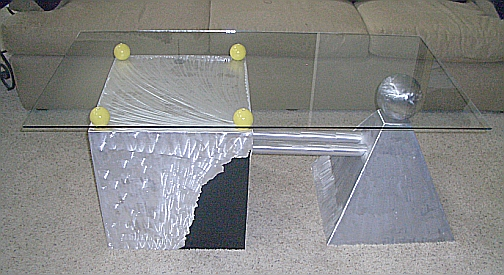 brushed aluminum table with glass top