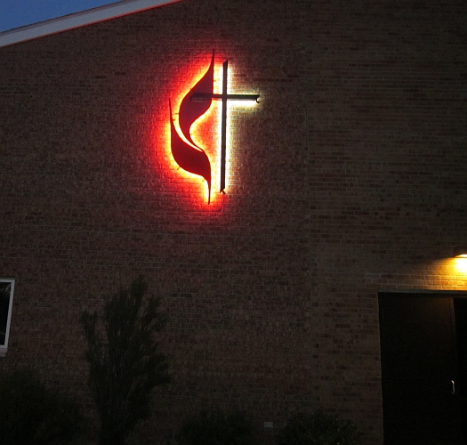 united mthodist cross and flame logo sign. United methodist croos and flame backlit in red and white LED