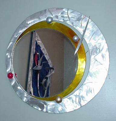 modern wall mirror, circle shaped mirror, Mirror in brushed aluminum and contemporary style mirror. Mirror is abstarct mirror with a modern mirror flare.
