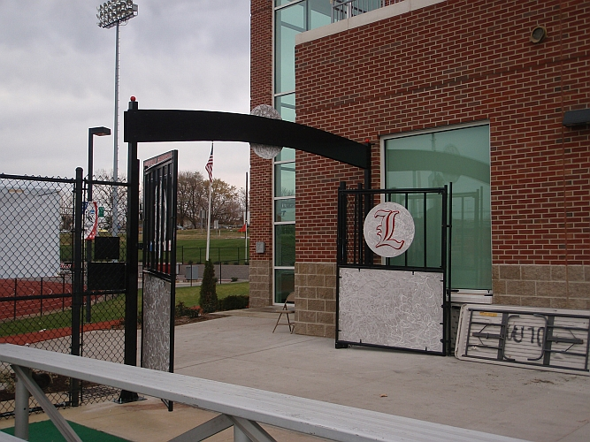 university of louisville field hocky field and U of L logo in aluminum and gates and awning with UofL logo
