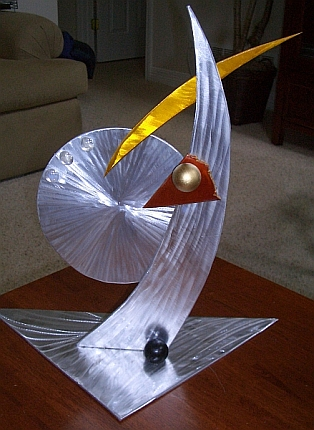 tabletop sculpture in aluminum and metal. mantle sculpture and small sculpture for a abstract sculpture