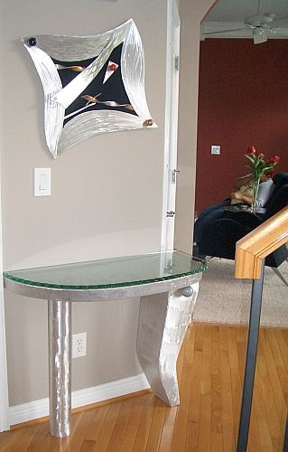 modern foyer table in brushed aluminum