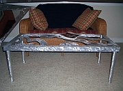 funky art table in brushed aluminum, art furniture and abstract coffee table in brushed aluminum