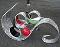 aluminum sculpture and tabletop sculpture